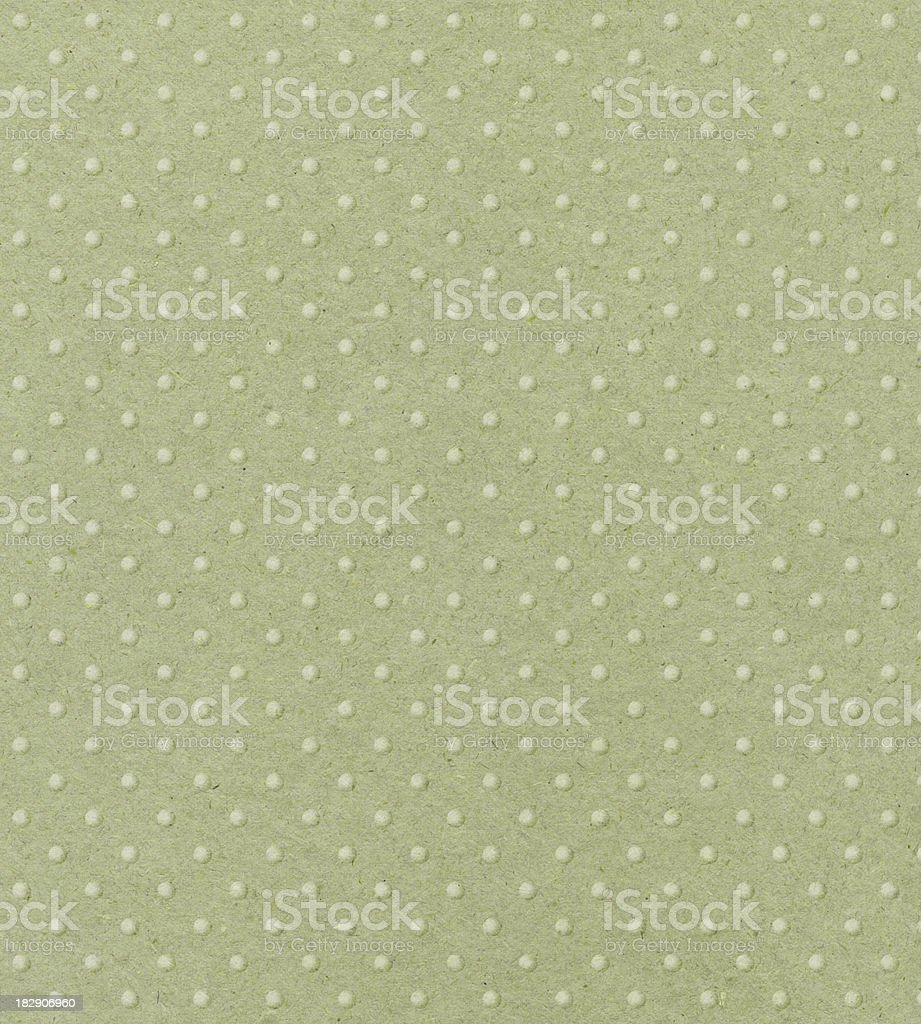 pale green paper with raised dots stock photo