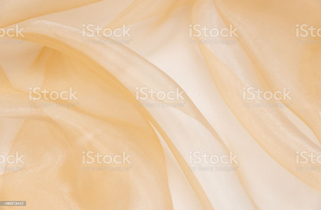 Pale pink organza fabric with folds stock photo