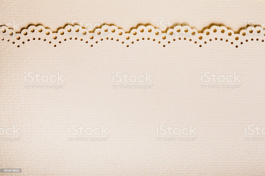 Pale pink paper with scalloped edge stock photo