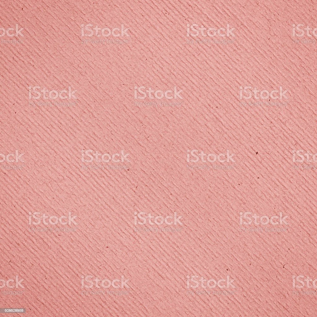 Pale pink textured paper stock photo