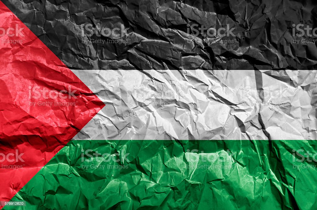 Palestine flag painted on crumpled paper background stock photo
