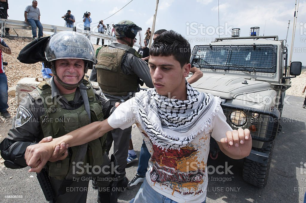 Palestinian arrested by Israeli soldiers stock photo