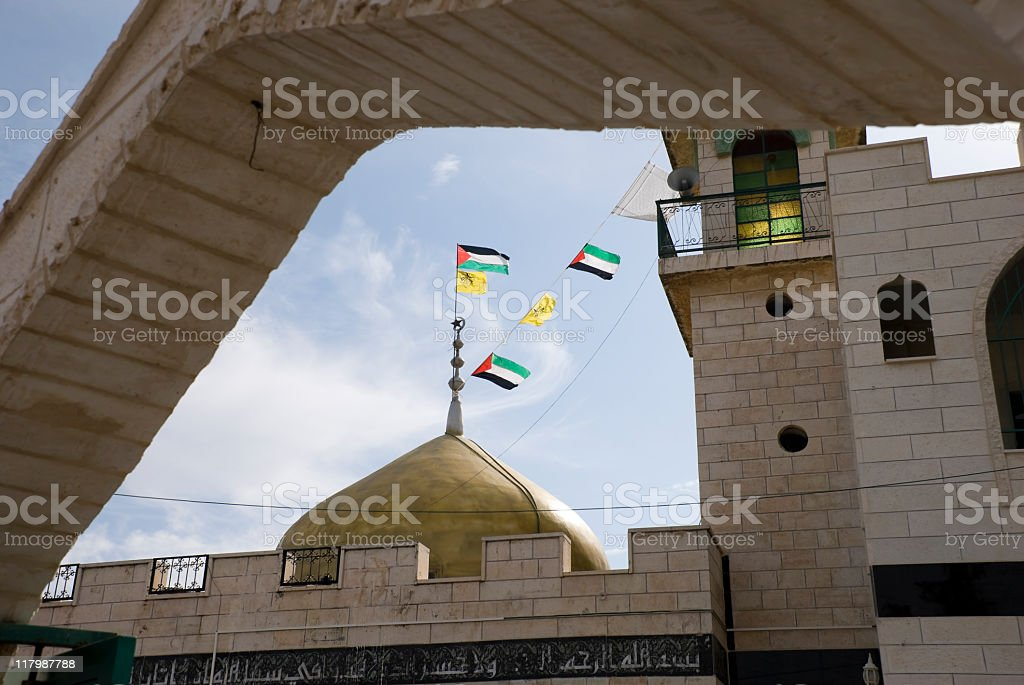 Palestinian Flags and Mosque in West Bank village of Bil'in stock photo
