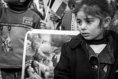 Palestinian girl in Ramallah at protest over Gaza City murders