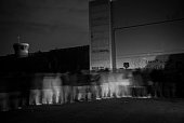 Palestinian laborers waiting in pre-dawn line at Bethlehem checkpoint