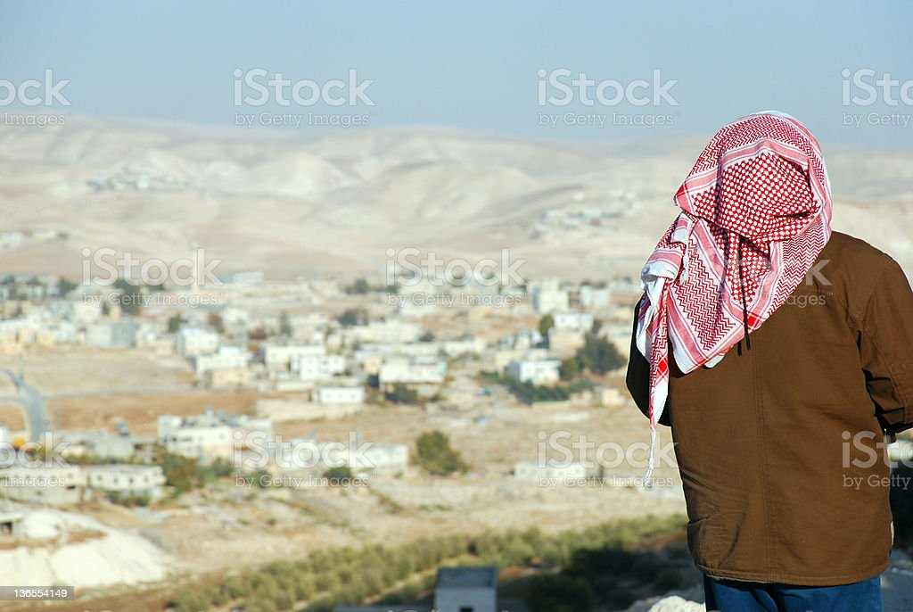 Palestinian man looking at West Bank landscape from the Herodian stock photo