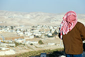 Palestinian man looking at West Bank landscape from the Herodian