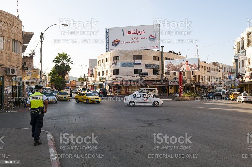 Palestinian policeman in West Bank town of Jenin royalty-free stock photo