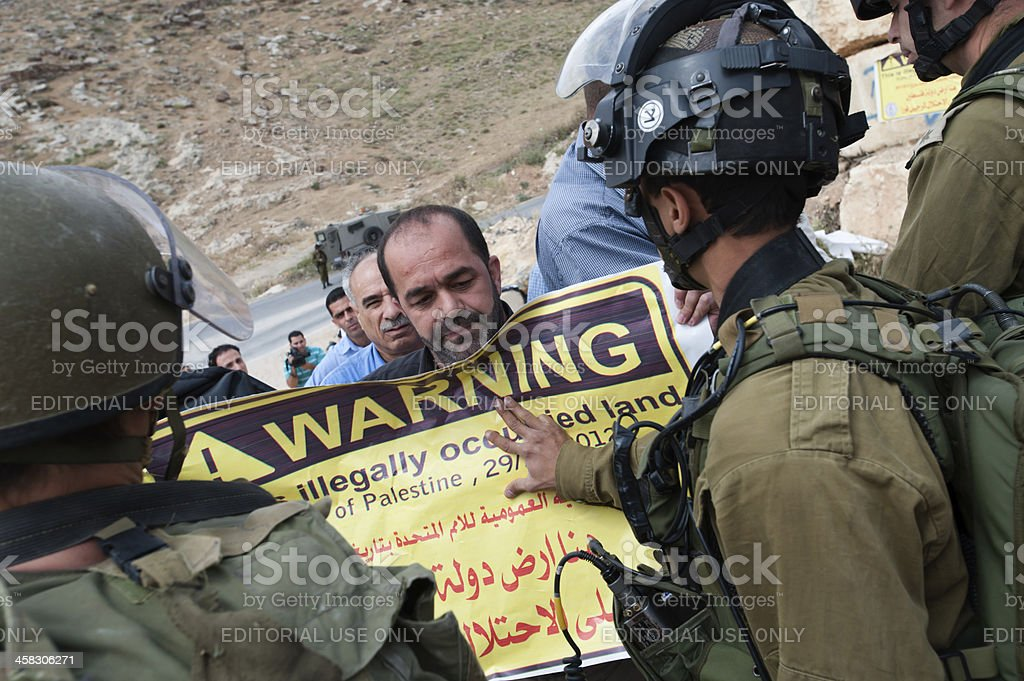 Palestinian protest and Israeli soldiers stock photo