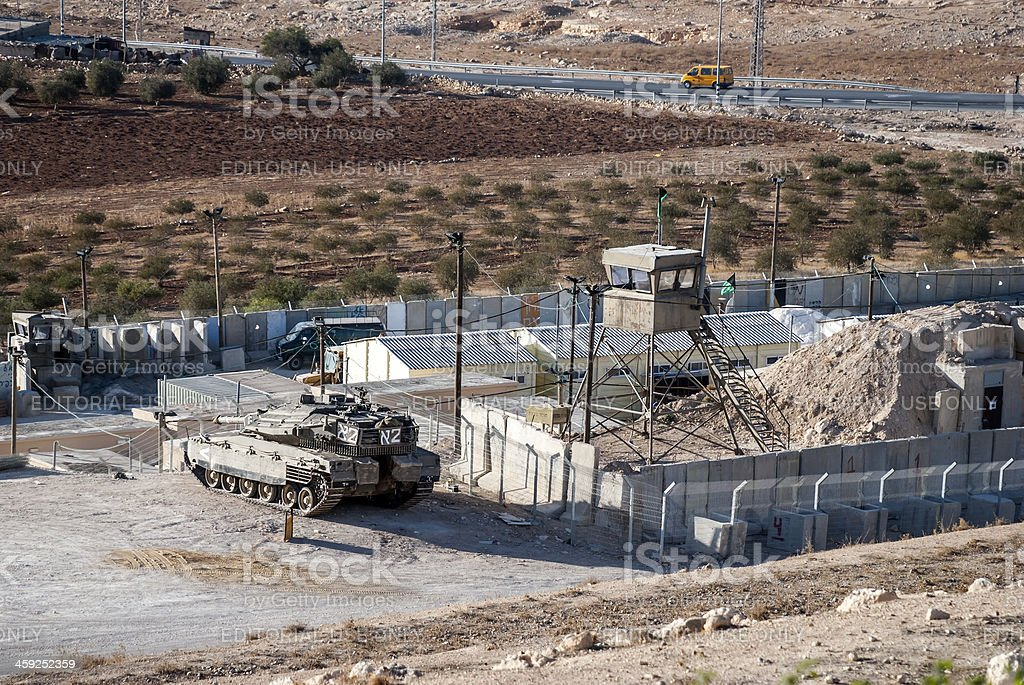 Palestinian taxi and Israeli tank stock photo