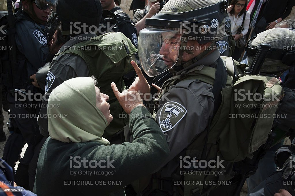 Palestinian woman confronts Israeli soldier stock photo