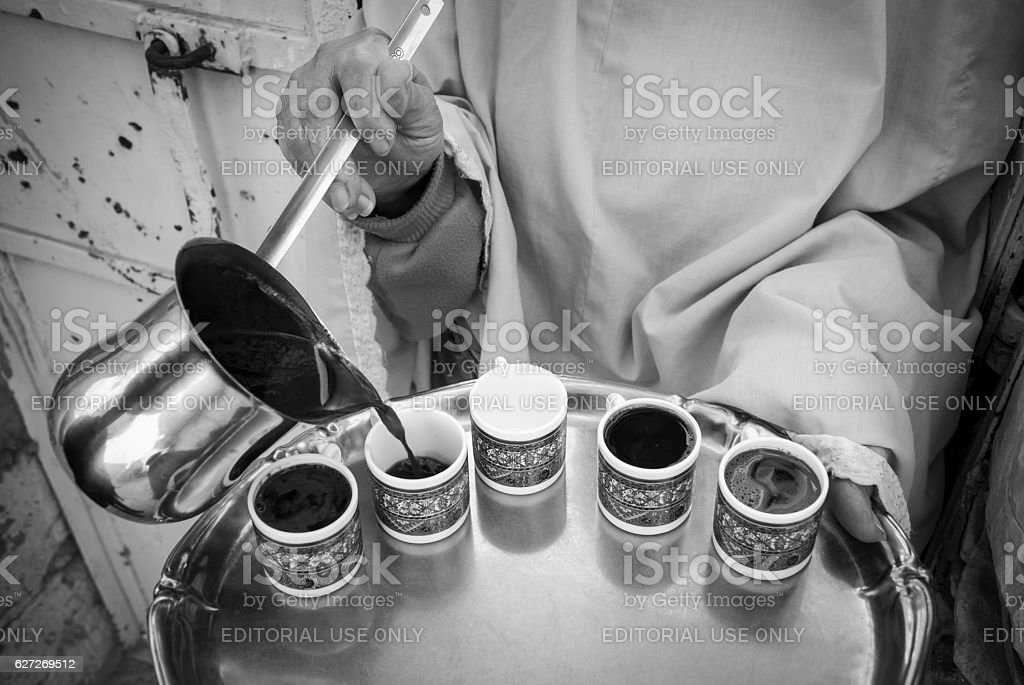 Palestinian woman pouring coffee in Jerusalem stock photo