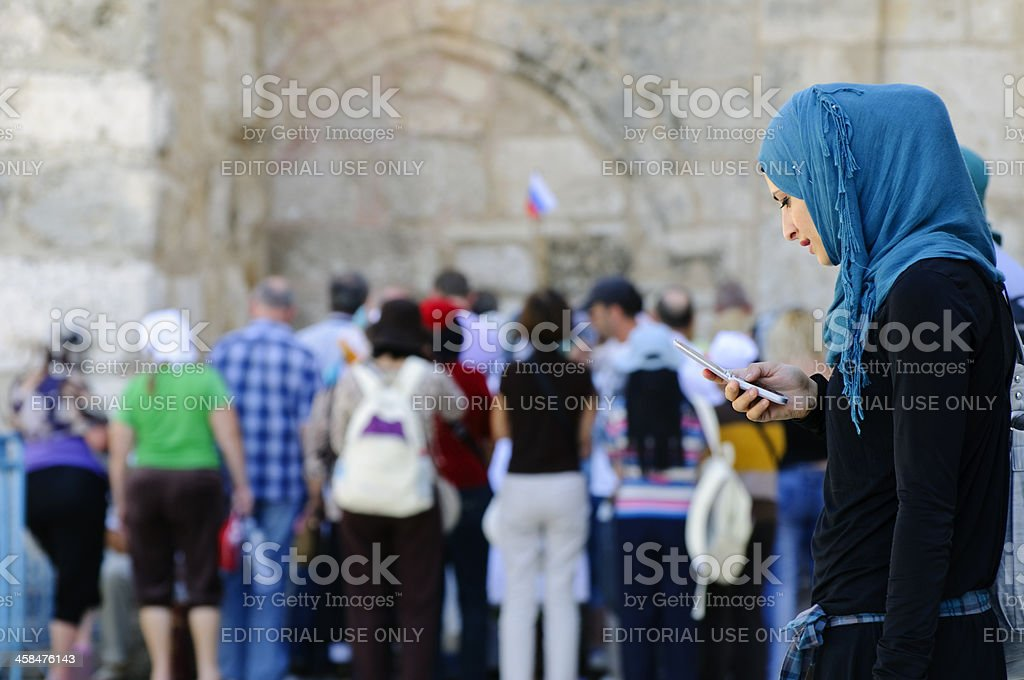 Palestinian woman with mobile phone royalty-free stock photo
