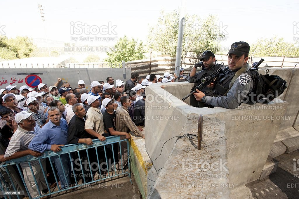Palestinians at Israeli military checkpoint royalty-free stock photo