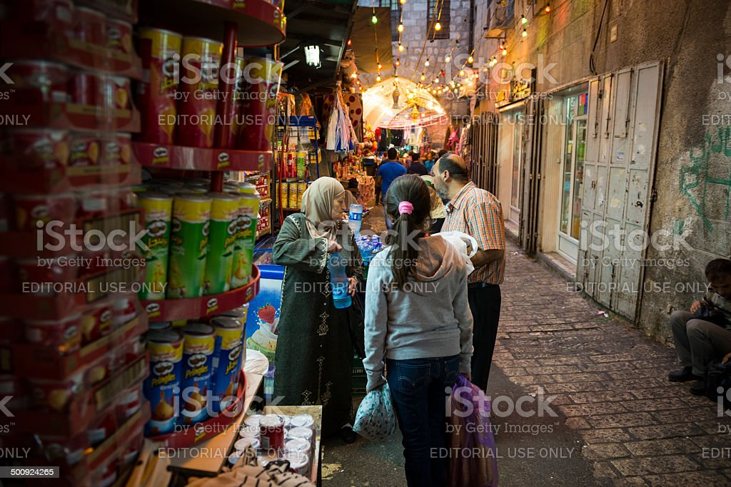 Palestinians shopping in Jerusalem's Muslim Quarter stock photo