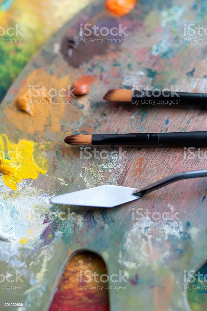 Palette and paintbrushes stock photo