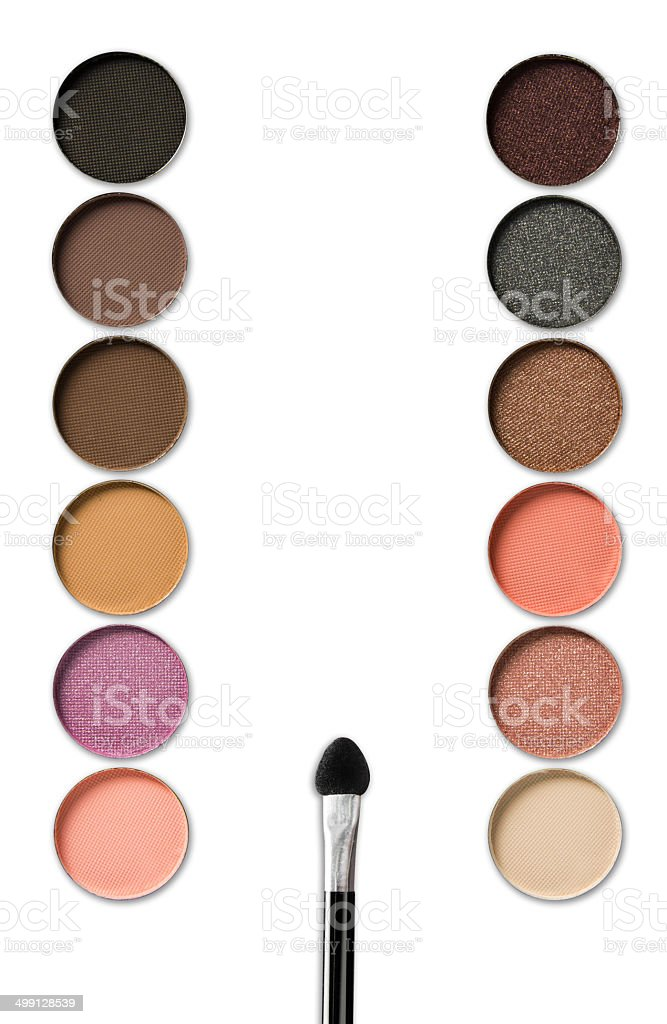Palette of colorful eye shadows with brush isolated on white stock photo