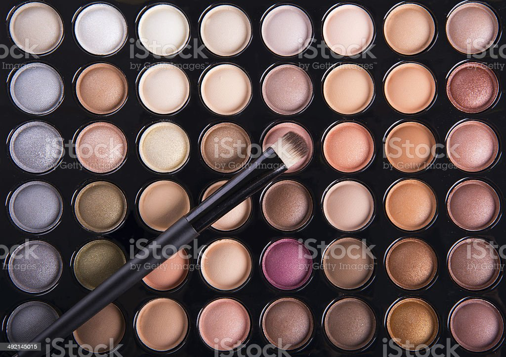 Palette of colorful eye shadows with brush stock photo