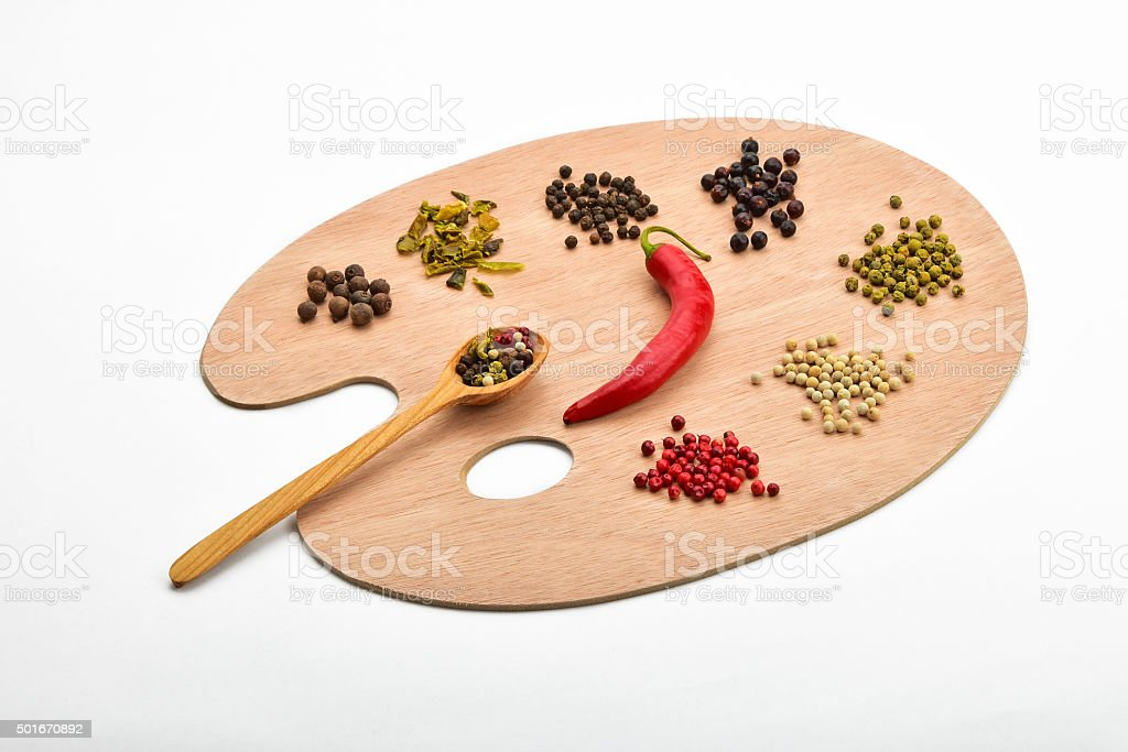 Palette of various spices on wooden palette isolated on white royalty-free stock photo