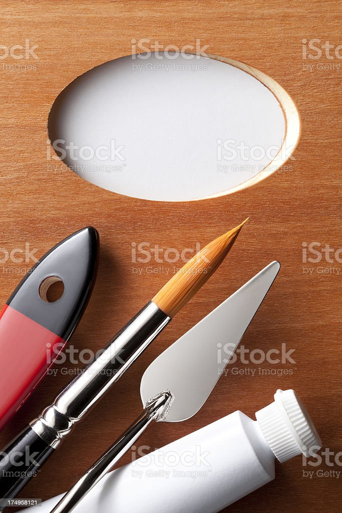Palette with artist brushes, paint tube and spatula stock photo