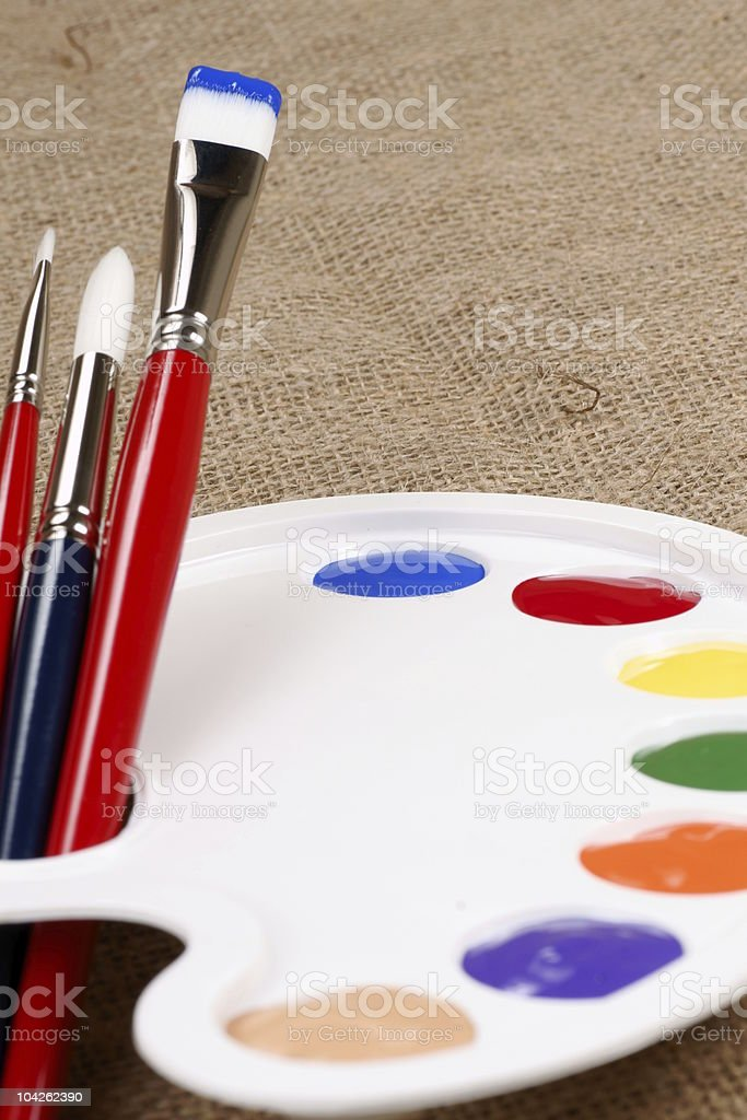 palette with paint and brushes royalty-free stock photo