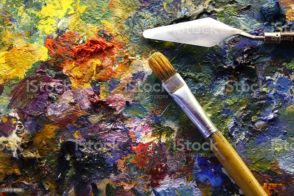 palette with paintbrush and palette-knife stock photo
