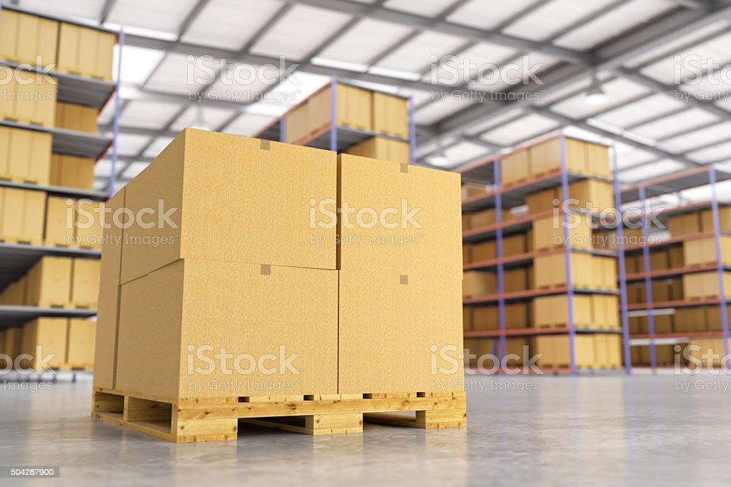 Pallet stacked with large cardboard boxes in warehouse stock photo
