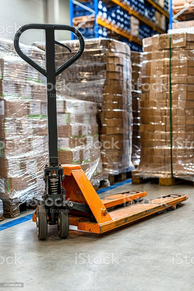 Pallet truck in warehouse stock photo