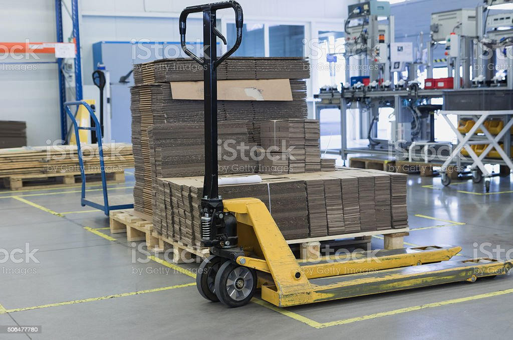 Pallet truck is standing in the assembly hall stock photo
