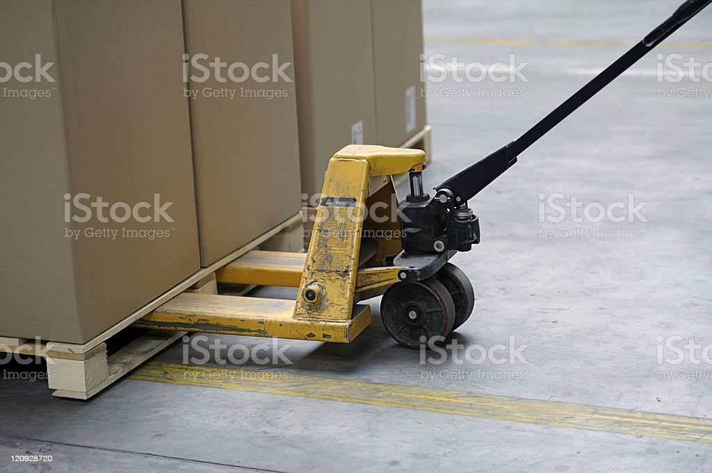 pallet truck with carton boxes stock photo