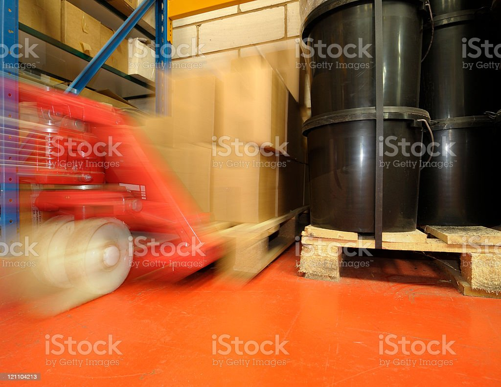 Pallet-truck Moving a Pallet royalty-free stock photo