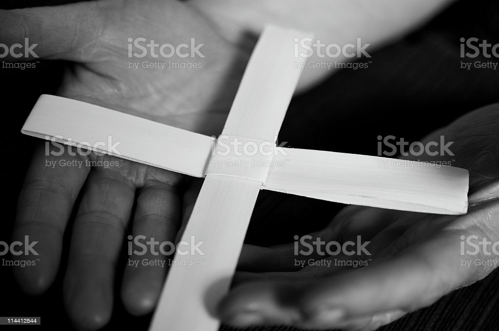 Palm crucifix held in mature hands royalty-free stock photo