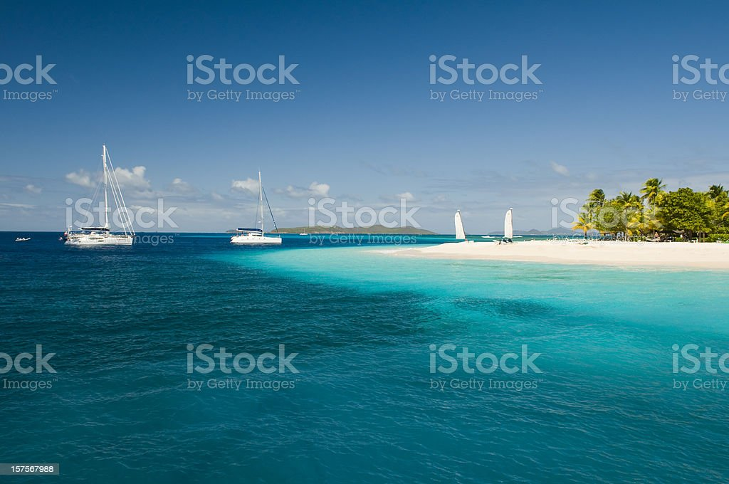 Palm Island Paradise - blue sea and white sand royalty-free stock photo