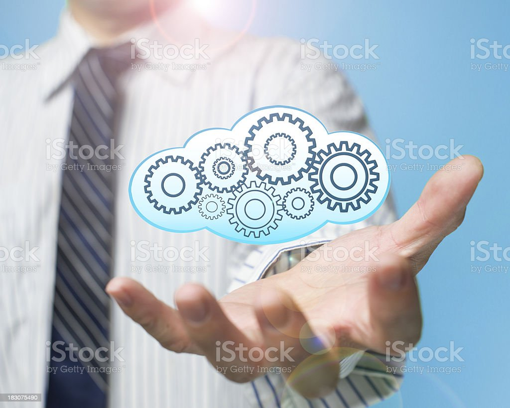 palm opening businessman with cloud filled gears royalty-free stock photo