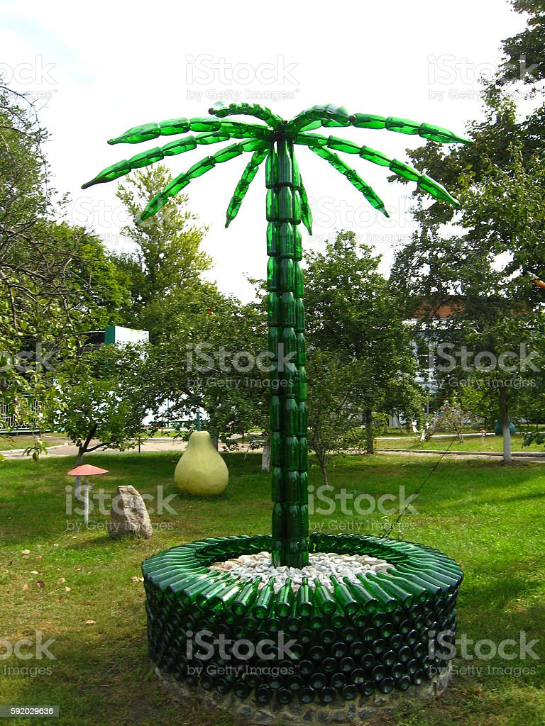 Palm tree made of bottles from a champagne stock photo
