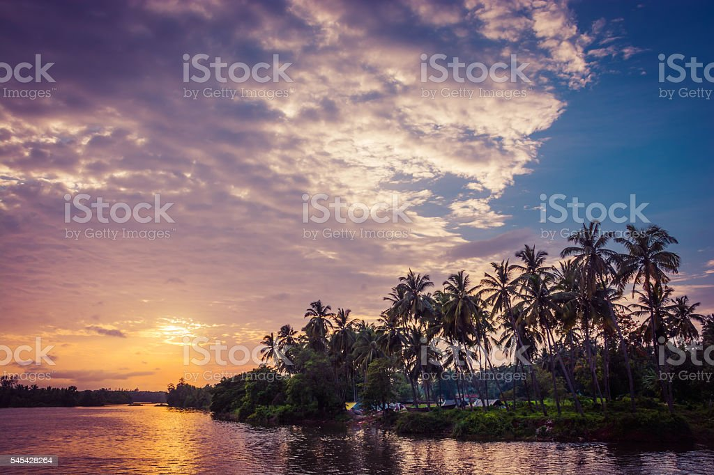 Palm Trees And Amazing Cloudy Sky On Sunset stock photo