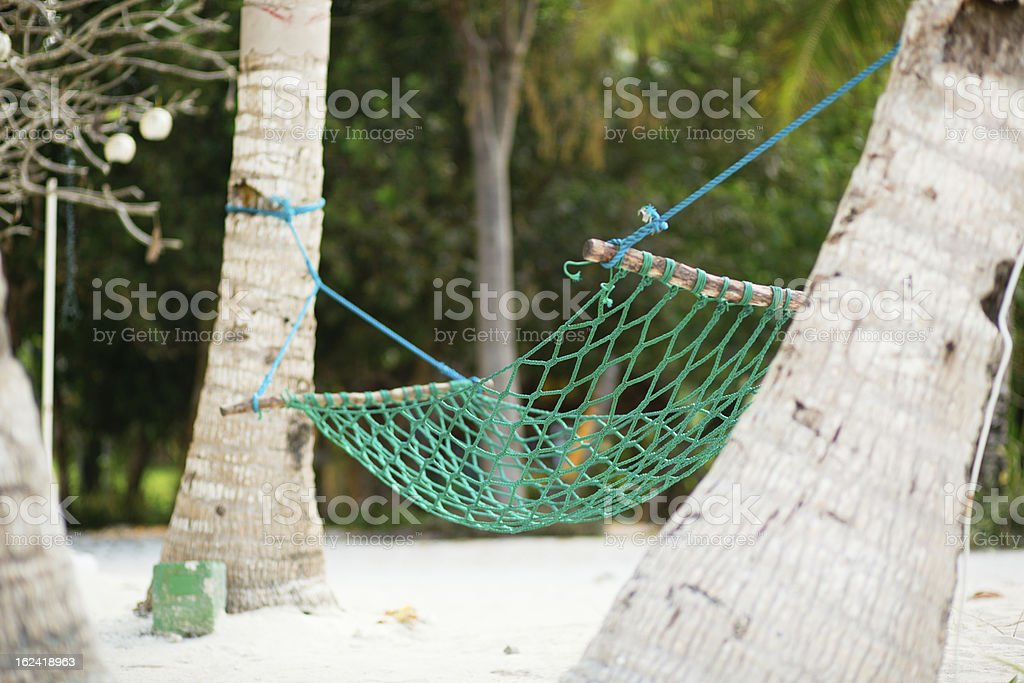 Palm trees and hammock on perfect white sand beach royalty-free stock photo