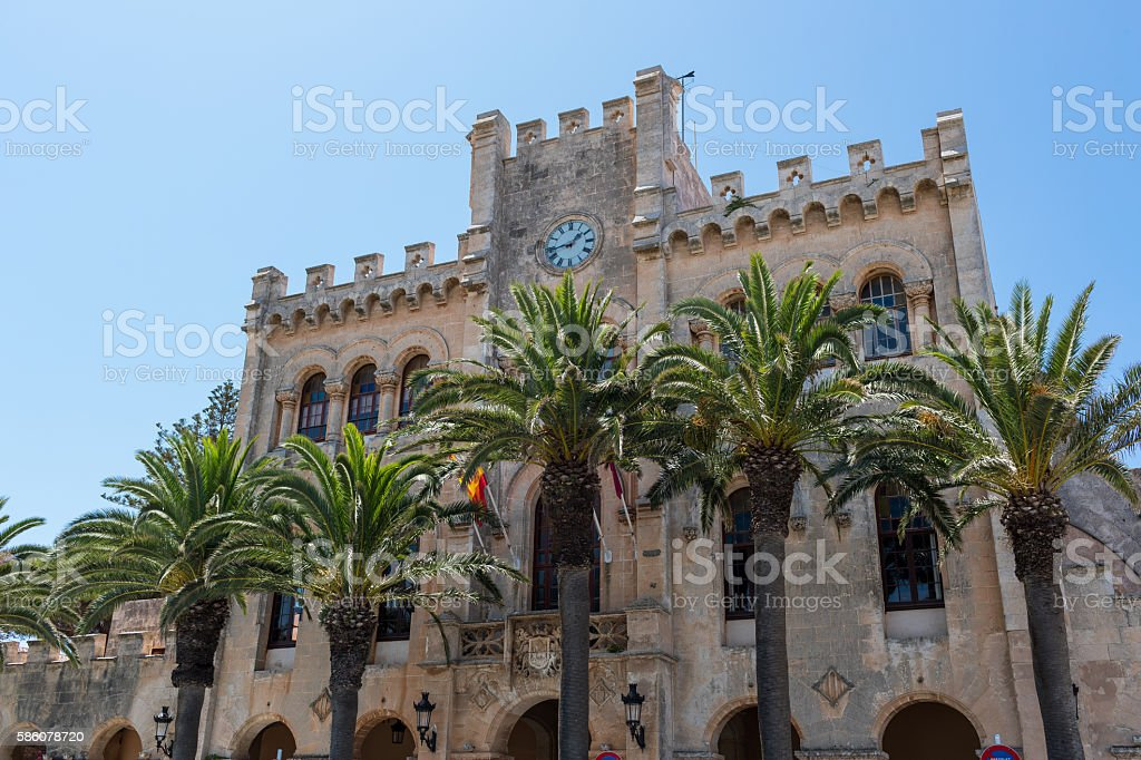 Palm trees in front of castle stock photo