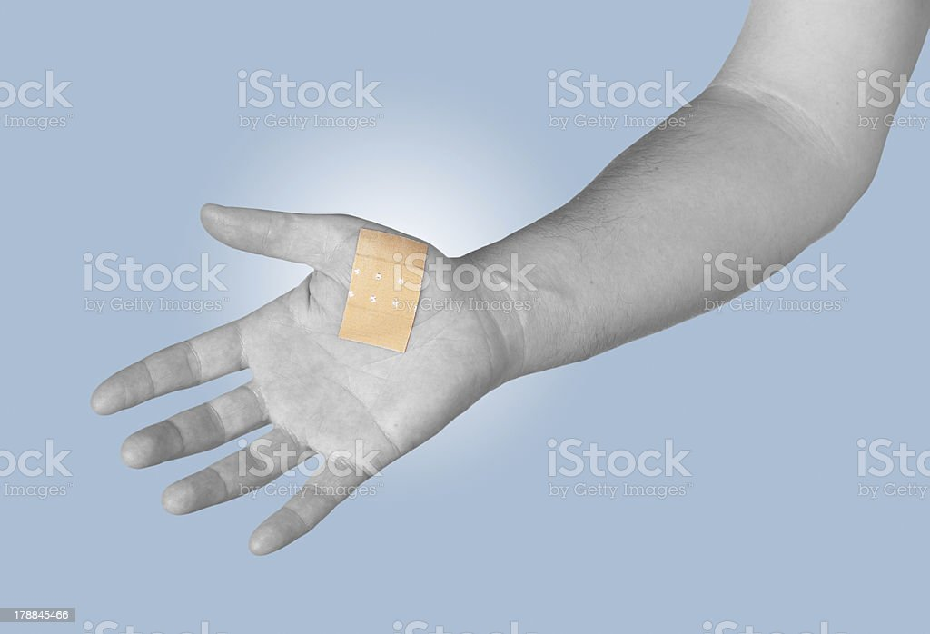 Palm with Healing plaster. royalty-free stock photo