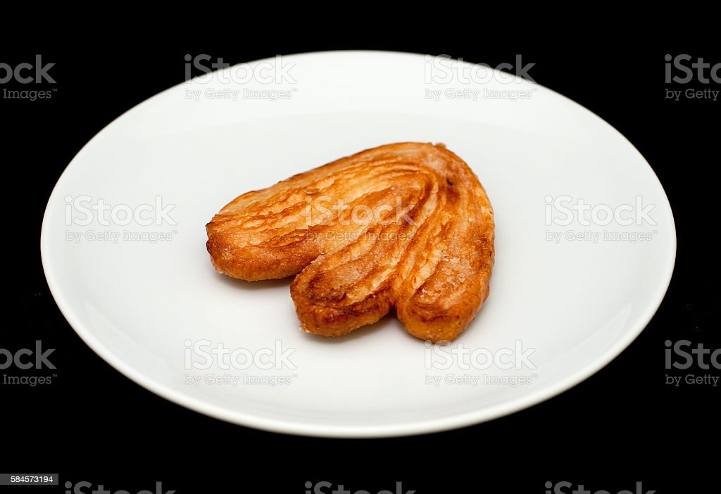 Palmier biscuit with sugar on the white plate close-up stock photo