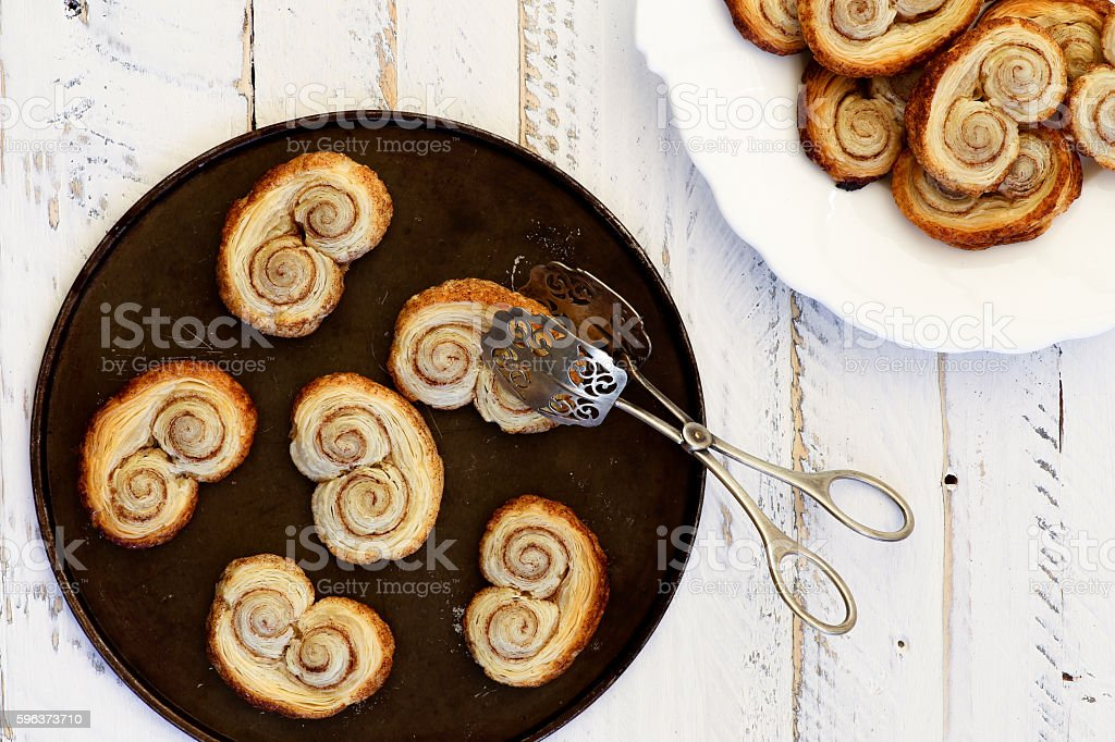 Palmier biscuits or french pastry made of puff pastry stock photo