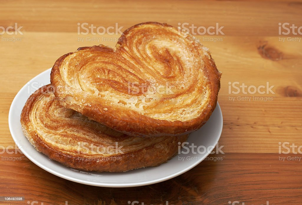 Palmier pastries on white saucer stock photo