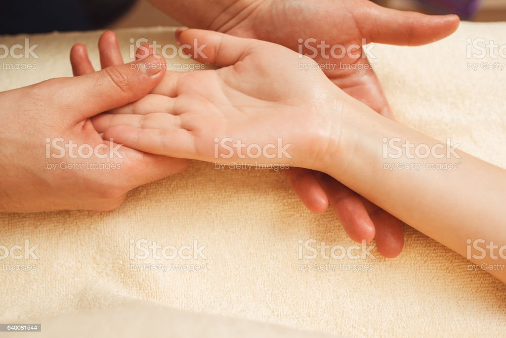 Palmist reading future through study of palm stock photo