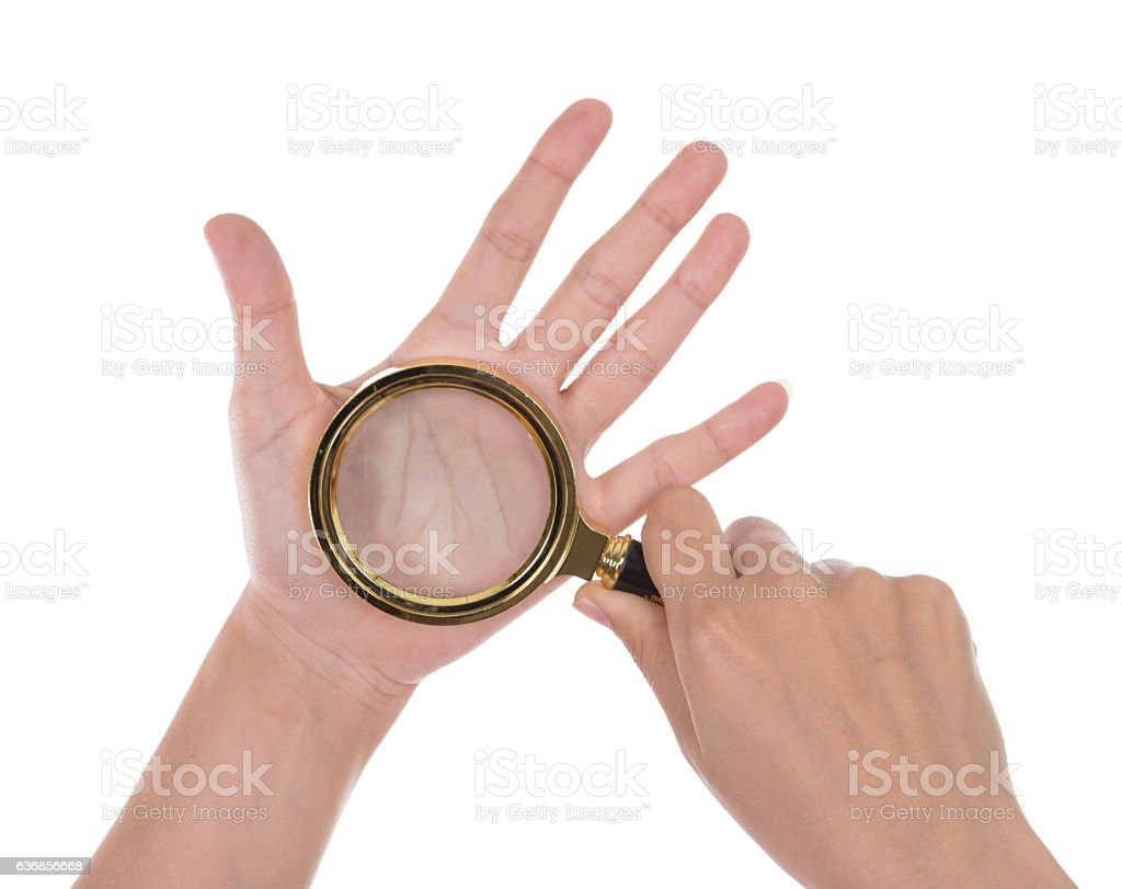Palmistry, hands and magnifying stock photo