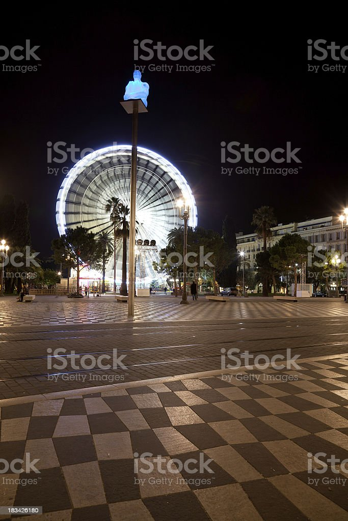 Palms with Ferris wheel  on the background royalty-free stock photo
