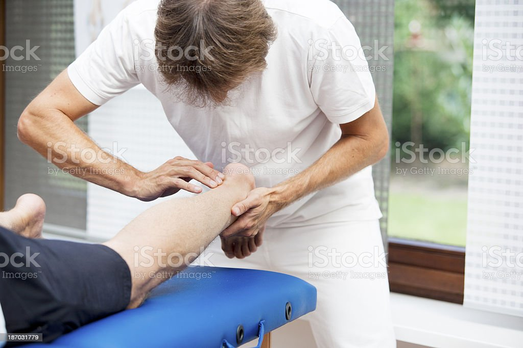 Palpation of Achilles tendon stock photo