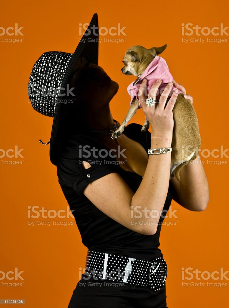 Pampering her dog royalty-free stock photo