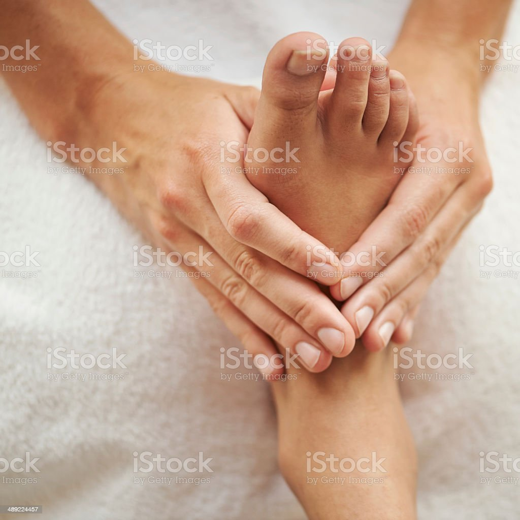 Pampering her pads stock photo