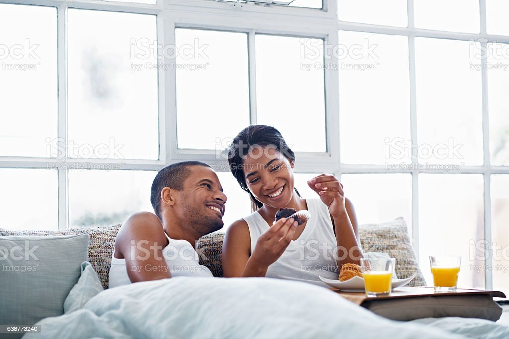 Pampering her with some breakfast in bed stock photo