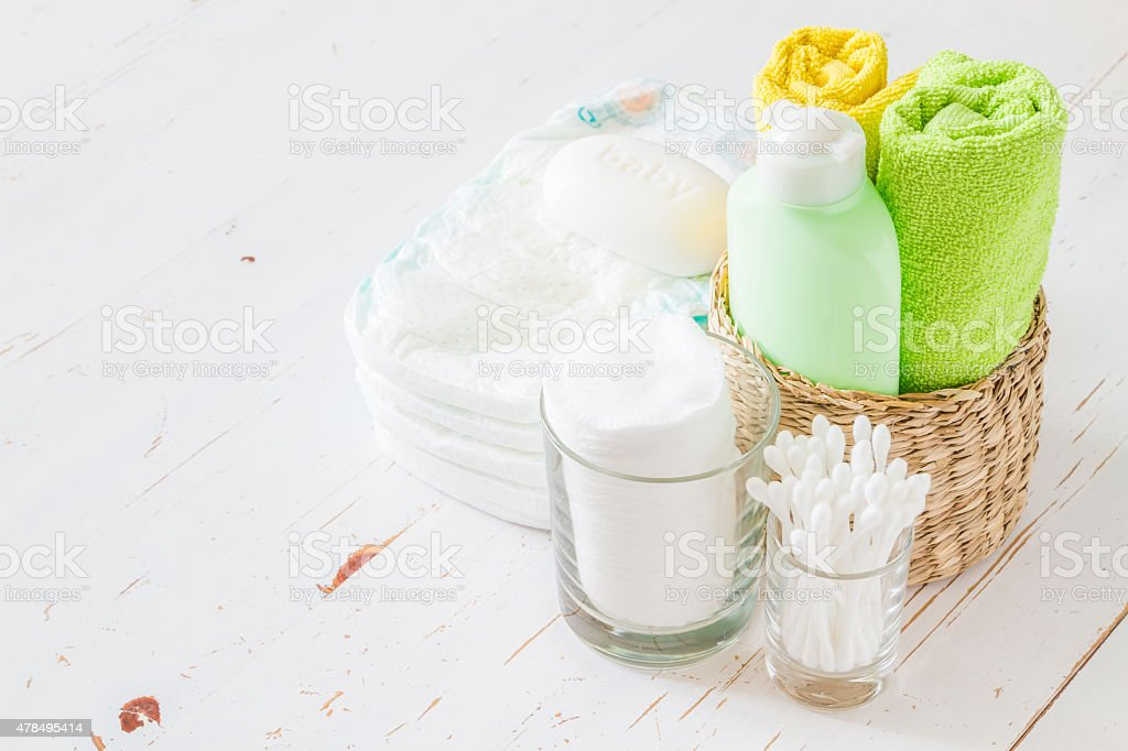Pampering - towels, diapers, lotion, cotton pads and sticks stock photo